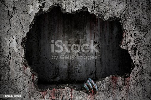 istock Hand of devil has stains and drops of blood and holding the damaged grungy crack and broken concrete wall in flooded sewer tunnel were abandoned, Bloody background scary and horror 1130071393