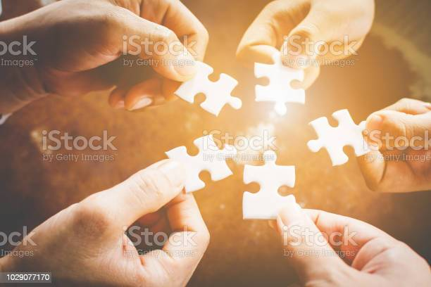 Hand of diverse people connecting jigsaw puzzle concept of and in picture id1029077170?b=1&k=6&m=1029077170&s=612x612&h=t80t7qcgliczc1hpx4h04yu o4gnjupcrtcgoslevyw=