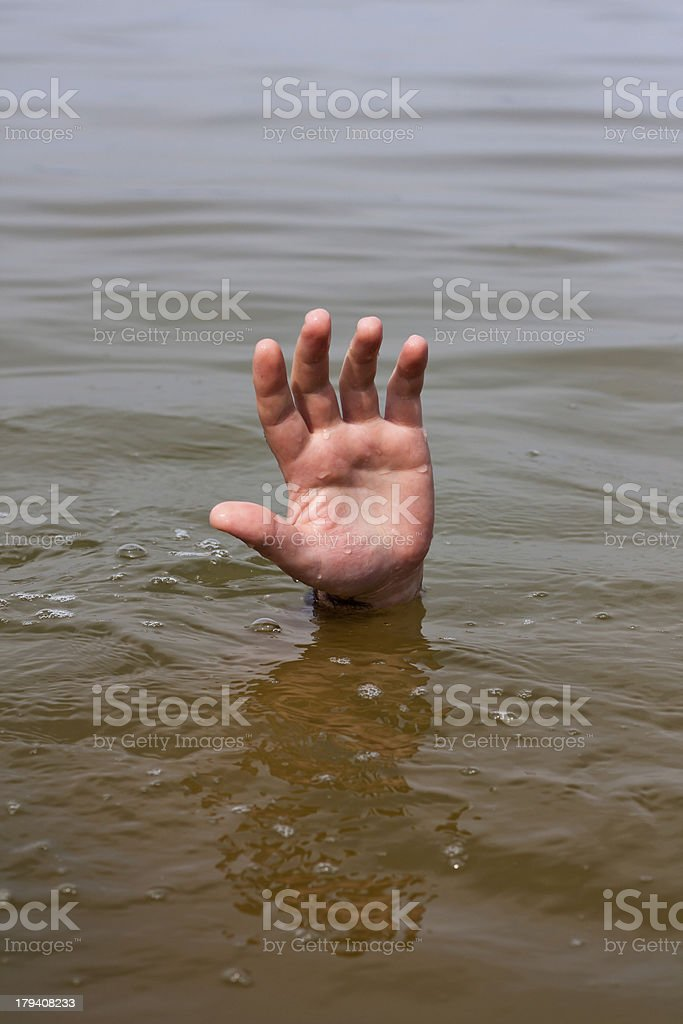 Hand of drowning man waits for help in the lake royalty-free stock photo