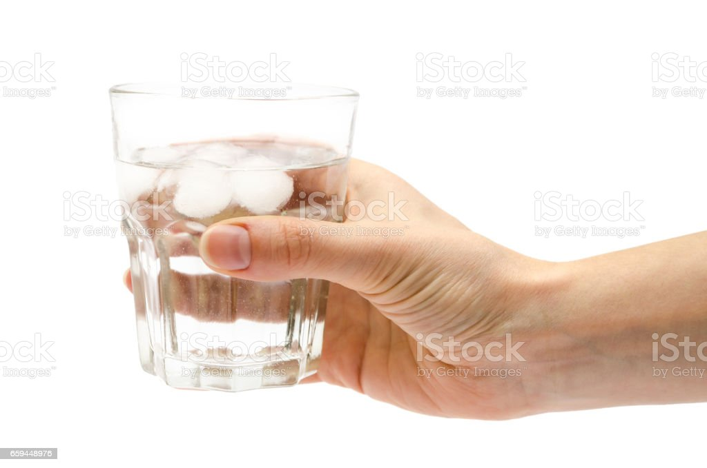 hand of girl holding glass of water stock photo