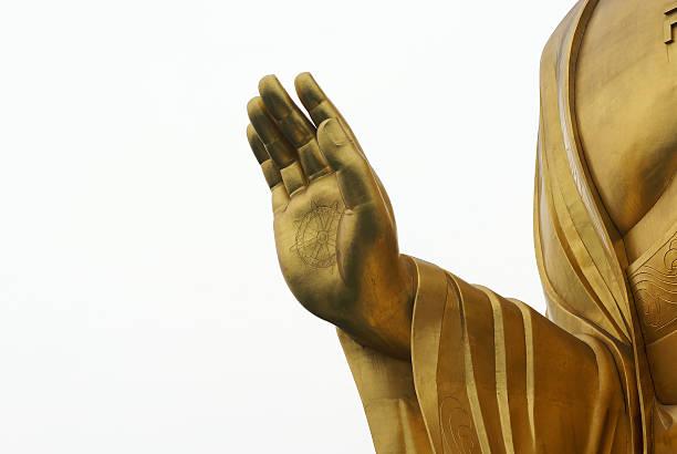 hand of golden buddha statue stock photo
