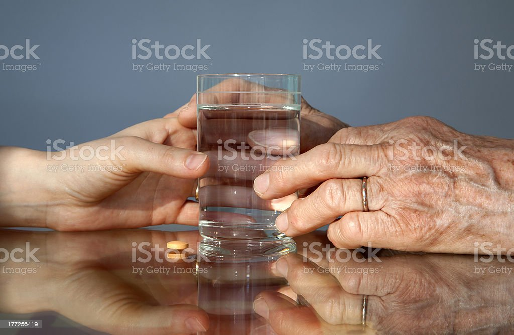 hand of grandmother and women with a pill royalty-free stock photo