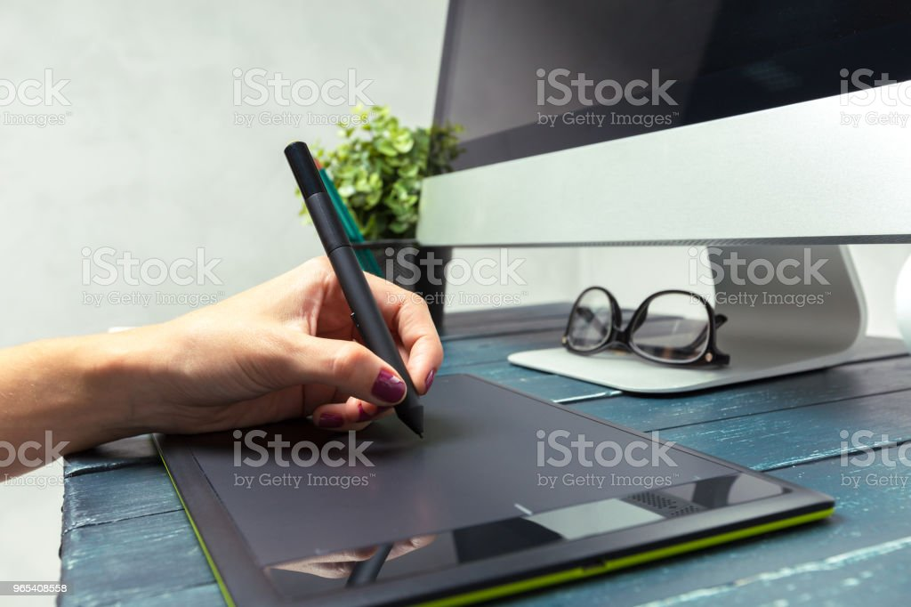 Hand of graphic designer working with stilus and tablet zbiór zdjęć royalty-free