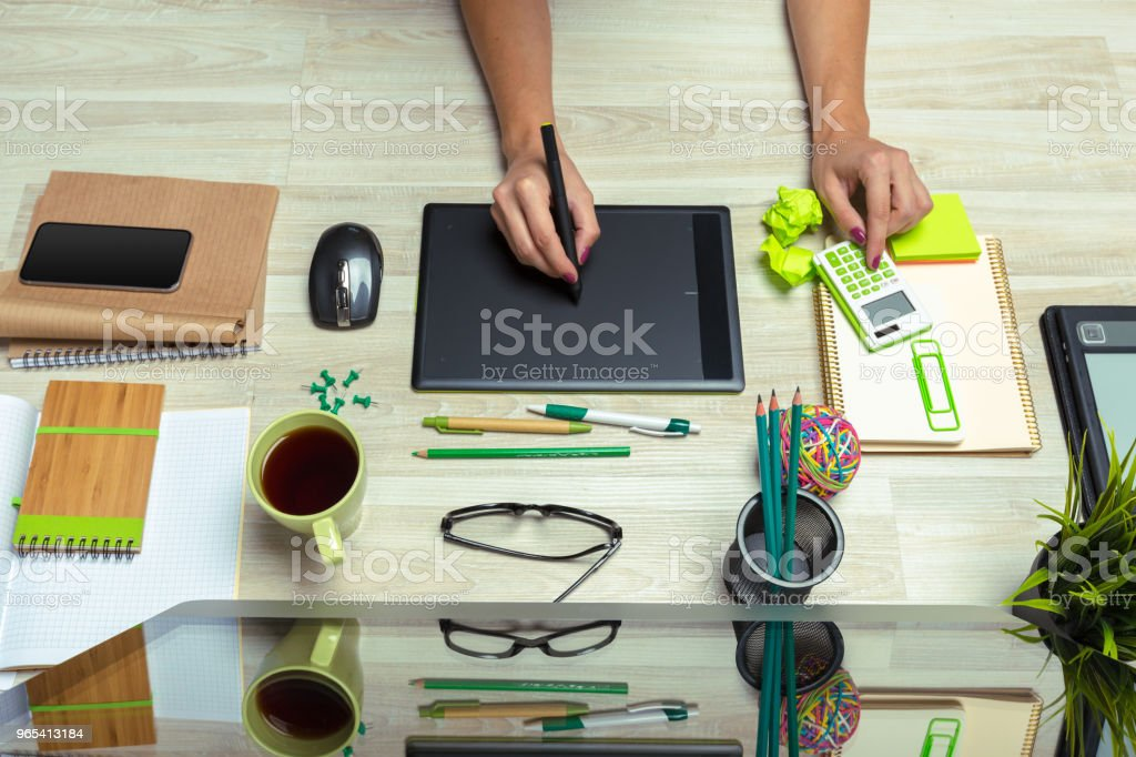 Hand of graphic designer working with stilus and tablet royalty-free stock photo