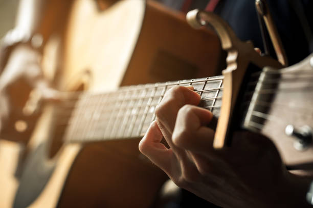 hand of guitarist and chord of guitar. stock photo