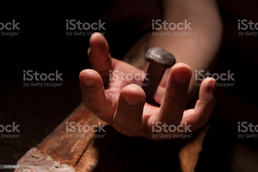 Hand of Jesus pierced with a nail stock photo