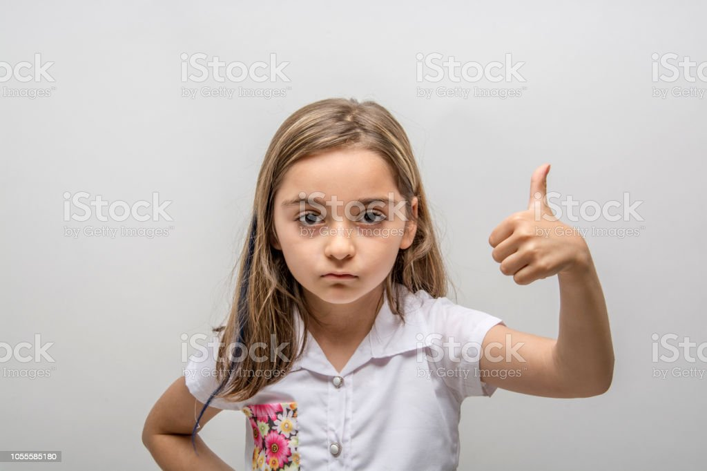 Hand of kids hand gesture of thumbs up. Isolated on white background -  Stock image .