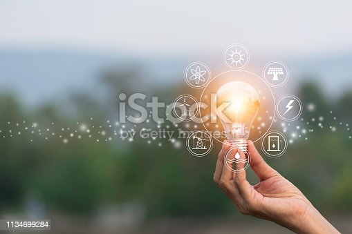 istock Hand of male holding a light bulb and copy space for accounting, ideas and creative concept. 1134699284