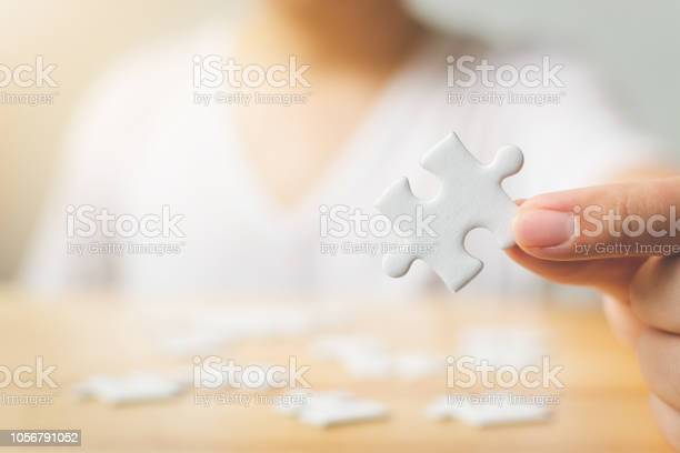 Hand of male trying to connect pieces of white jigsaw puzzle on picture id1056791052?b=1&k=6&m=1056791052&s=612x612&h=gec y pep6lwip4dfzbnih6pwerbmv02o7zmpb bece=
