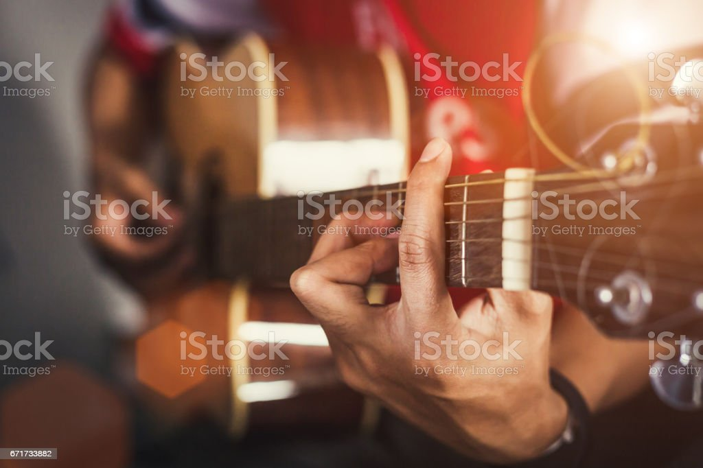 hand of man in classical guitar stock photo
