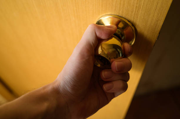 Hand of man opening a old door. stock photo