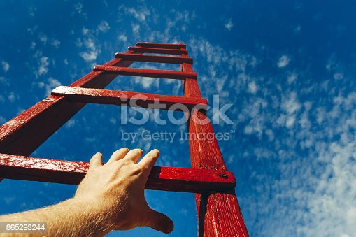 Hand Of Man Reaching For Red Ladder Leading To A Blue Sky Development Motivation Career Growth Concept Stock Photo & More Pictures of Achievement