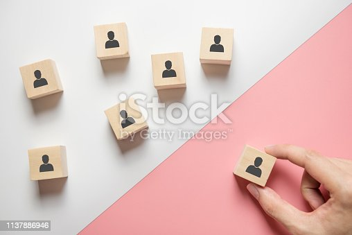 Hand of man search of new employees and specialists. Human Resource Management. The concept of personnel selection and management within the team.