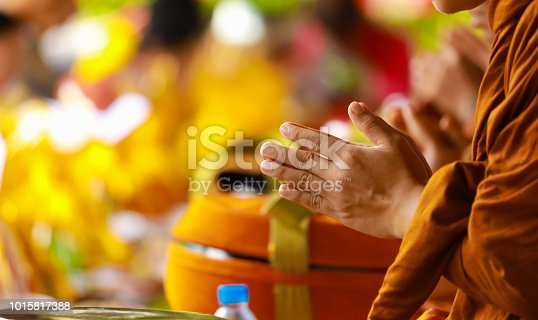 hand of monk in Buddhist prayer process.