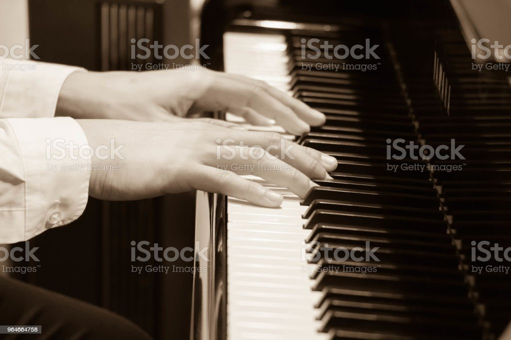 hand of musician playing piano royalty-free stock photo