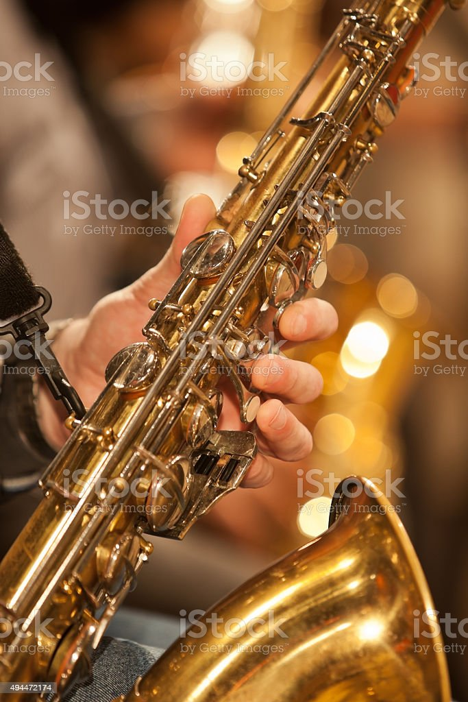 Hand of musician playing the saxophone stock photo