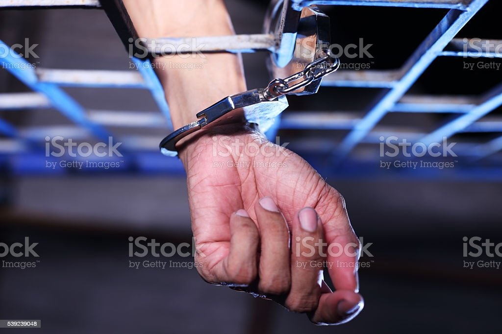 hand of prisoner in jail royalty-free stock photo