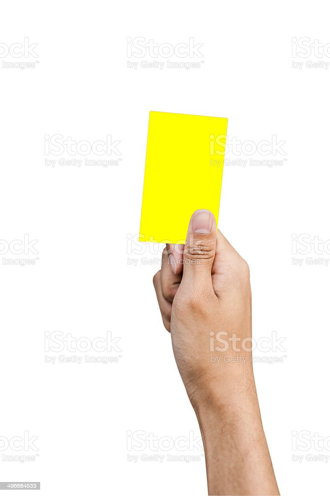 Hand of referee with yellow card isolated on white background stock photo