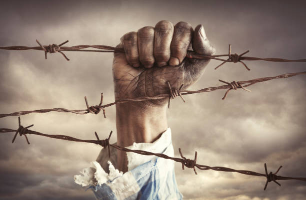 Hand of refugee holding barbed wire picture id946644844?b=1&k=6&m=946644844&s=612x612&w=0&h=rxnk1fxifvugpu5plfcf50lp9f8hrxqlwupe9lthivw=