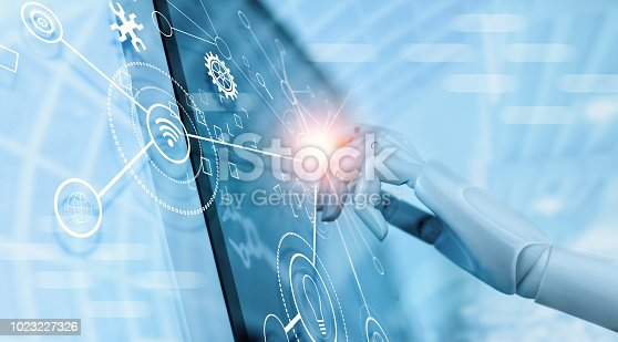 istock Hand of robot using over the interface virtual screen to check status and control automation robotics arms machine in intelligent factory industrial with icon flow and data exchange in manufacturing technology. AI. Futuristic technology and industry 4.0 c 1023227326