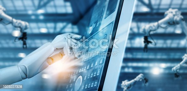 973130292 istock photo Hand of robot working on control panel in intelligent factory industrial monitoring system software. Check and control automation robot arms machine. AI. Welding robotics and digital manufacturing operation system. Futuristic technology. 1023227328