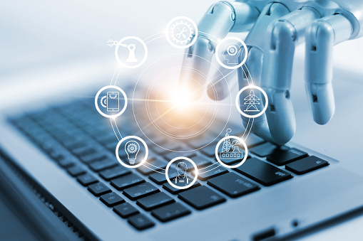 Hand Of Robotics Connecting To Industrial Network Connection On Laptop Artificial Intelligence Futuristic Technology And Manufacturing Concept Stock Photo - Download Image Now