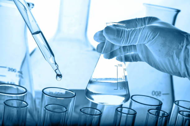 hand of scientist holding flask - laboratory stock photos and pictures