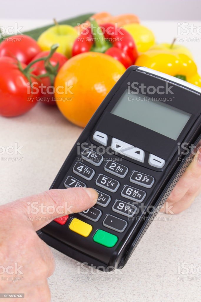 Hand of senior woman using payment terminal, enter personal identification number stock photo