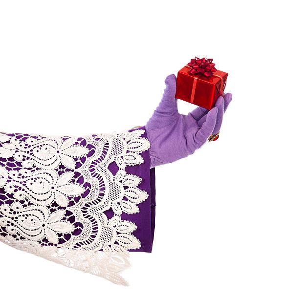 hand of sinterklaas showing gift. isolated - cadeau sinterklaas stockfoto's en -beelden