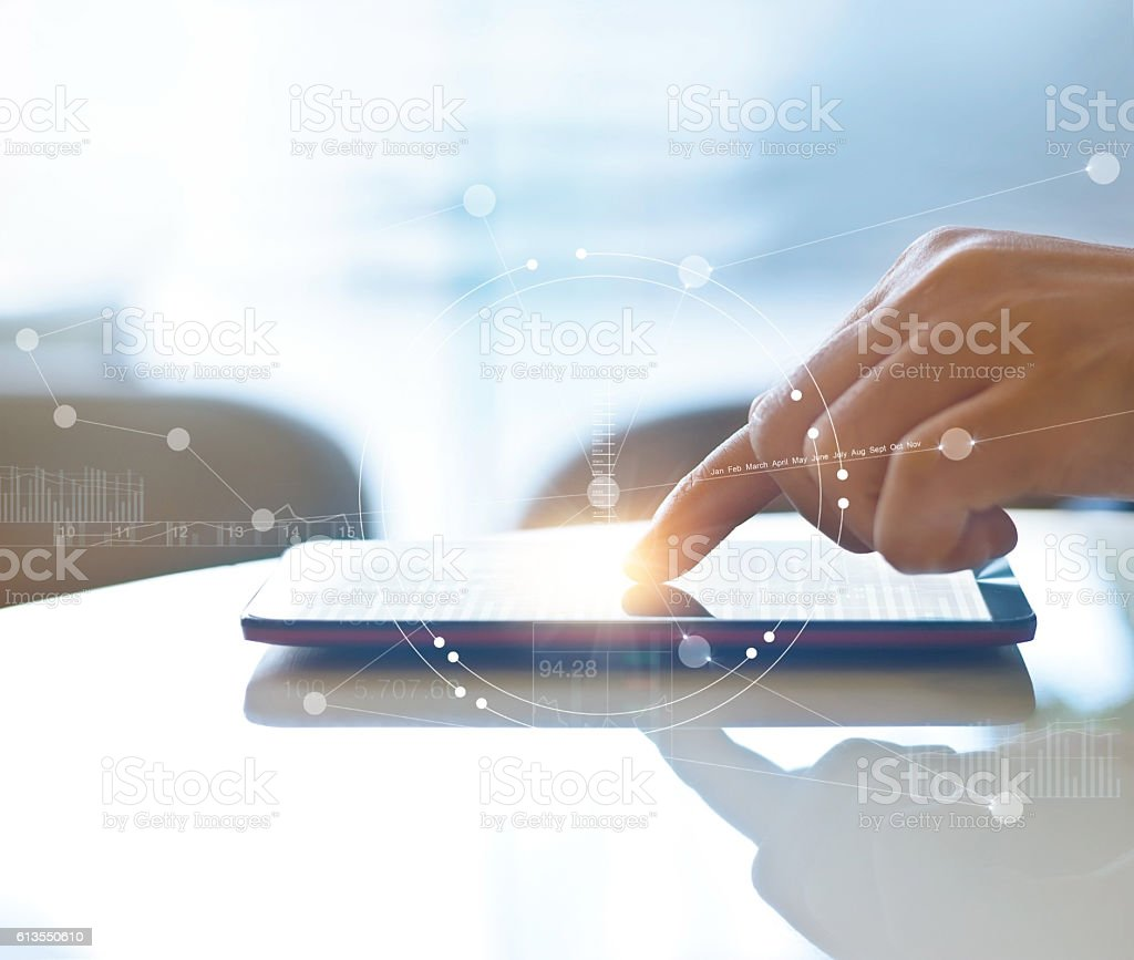 Hand of stock investment using smartphone for checking worldwide stock photo