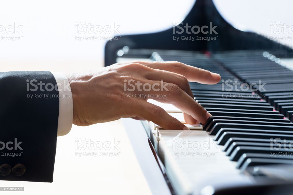 Hand of the pianist during performance stock photo