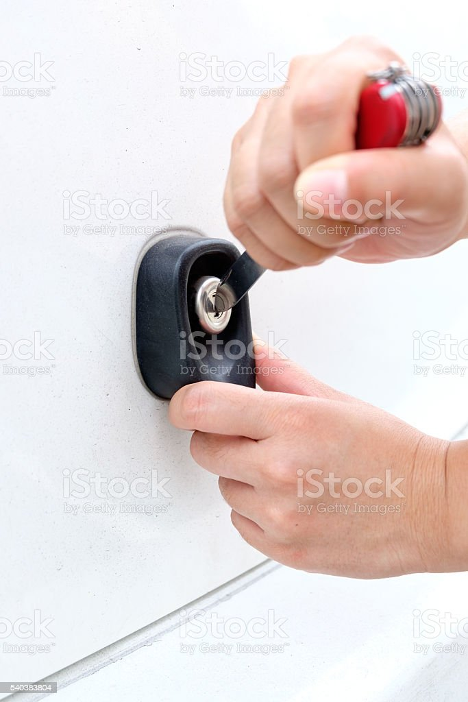 hand of Thief using knife try to opening Car Door stock photo