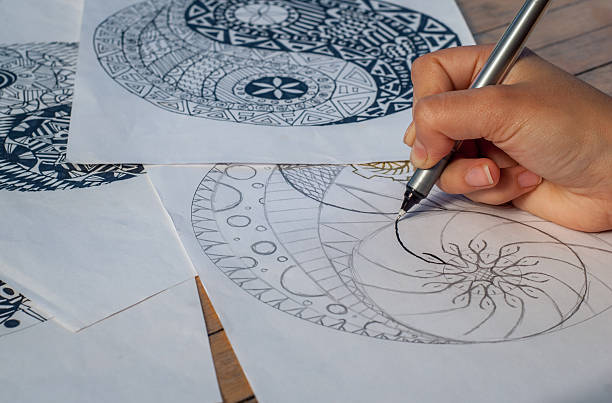 hand of woman drawing yin yang for anti stress coloring - mandala bildbanksfoton och bilder