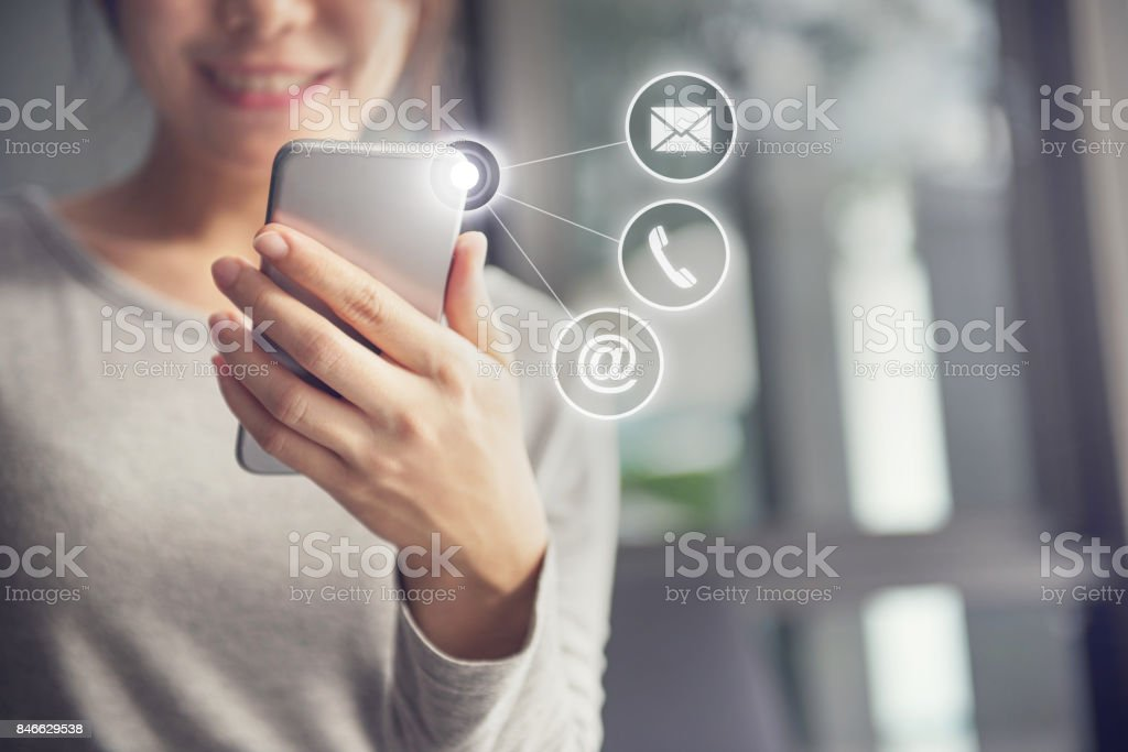 CONTACT US, Hand of Woman holding mobile smartphone with ( mail,phone,email ) icon. stock photo