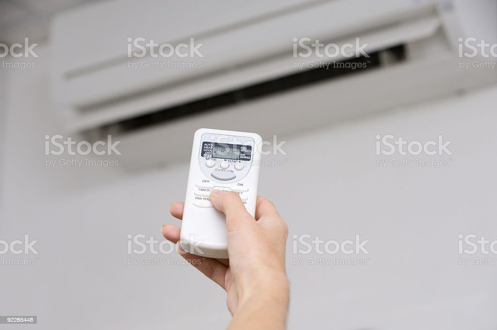 Hand of woman includes air-conditioner royalty-free stock photo