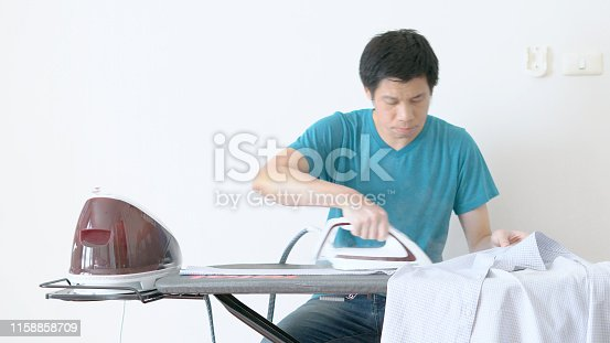 524159504 istock photo Hand of woman ironing clothes on the table 1158858709