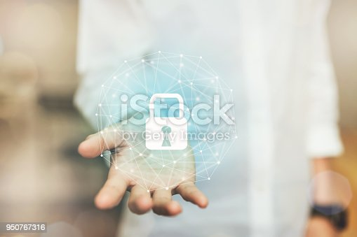 istock Hand of woman is protection digital network with lock icon. To prevent access to personal information. Concept cyber security. 950767316