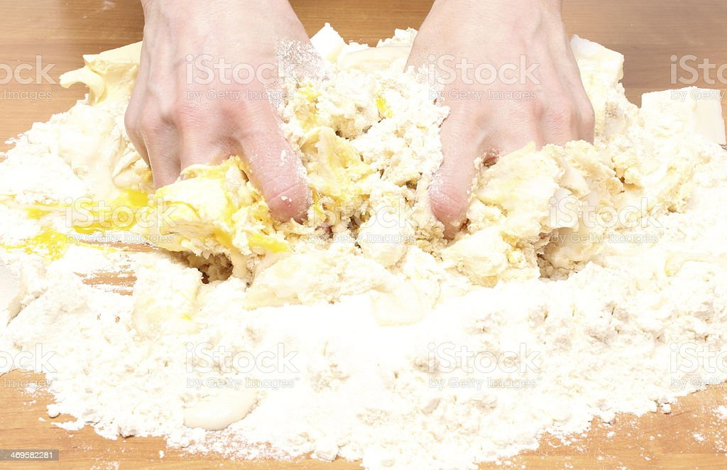 Hand of woman kneading dough for yeast cake royalty-free stock photo