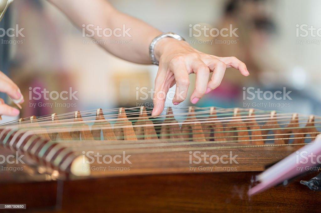 Hand of woman playing guzheng. stock photo