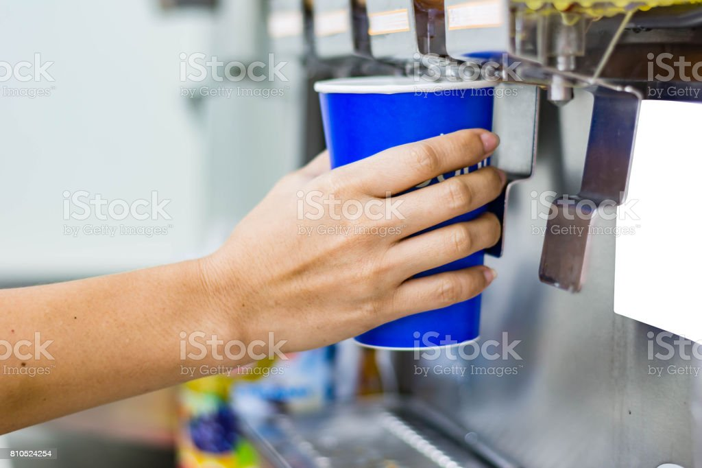 hand of woman serving beverage of cooler stock photo