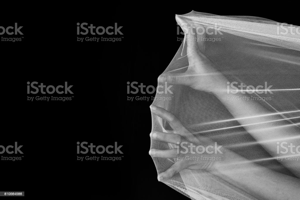 Hand of woman struggle in net, try to get out in white tone stock photo