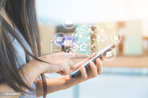 istock Hand of woman using smartphone with icon technology artificial intelligence (AI) and internet of things (IOT) 1194209602