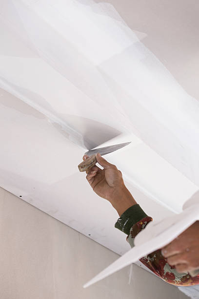 hand of worker using gypsum plaster ceiling joints hand of worker using gypsum plaster ceiling joints at construction site plaster ceiling design stock pictures, royalty-free photos & images