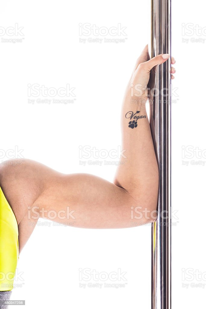Hand of young vegan pole dancer stock photo