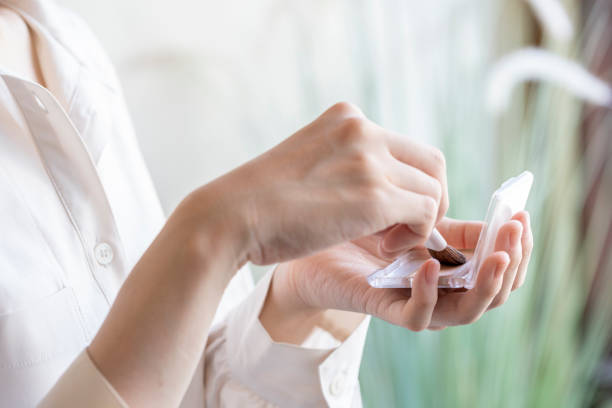 Hand of young woman when having foundation stock photo
