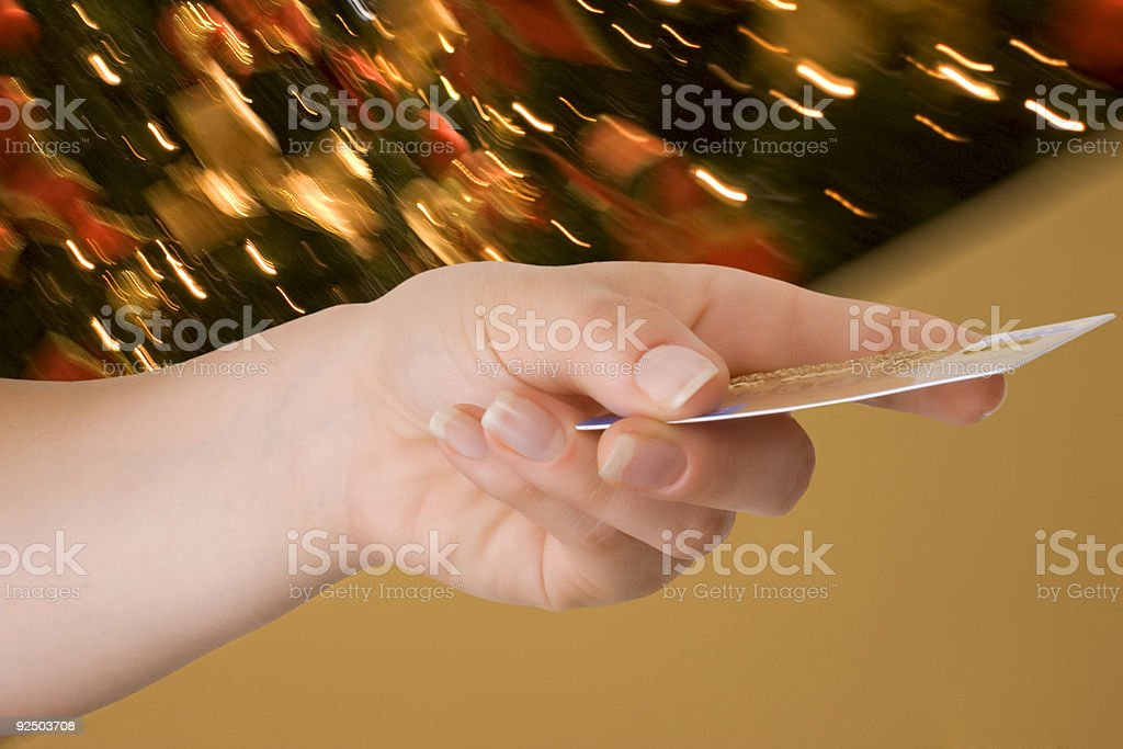 Hand Offering Credit Card, Blur Xmas Background royalty-free stock photo