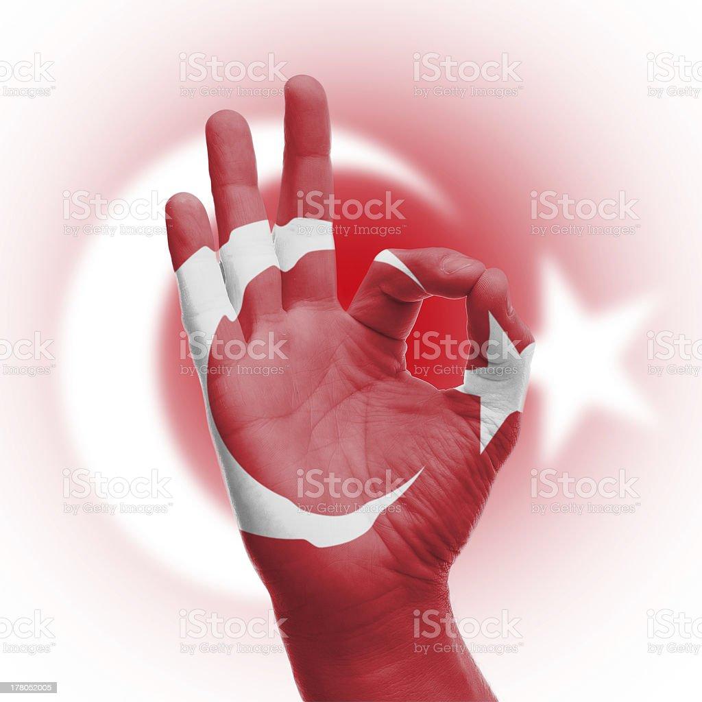 hand OK sign with Turkish flag stock photo