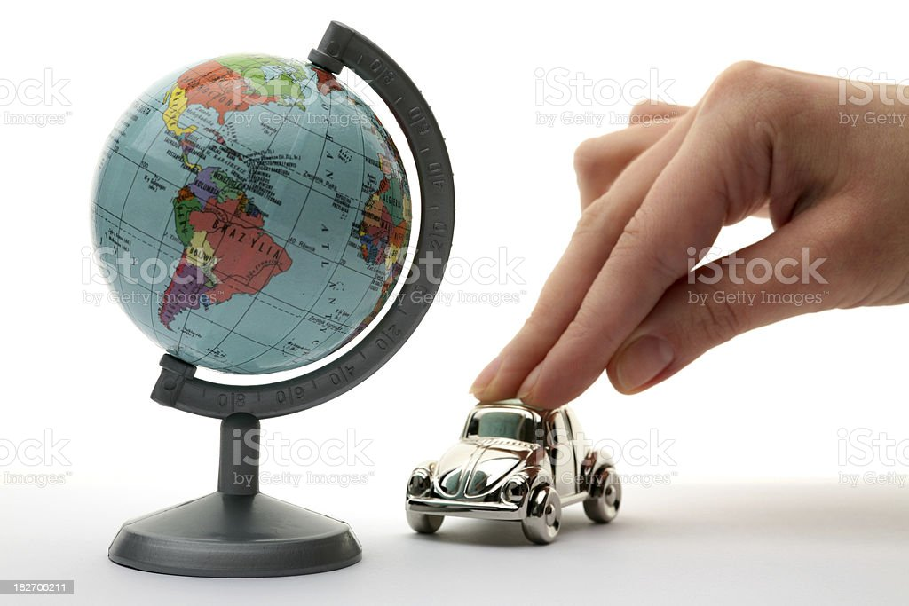 Hand on a car and globe royalty-free stock photo