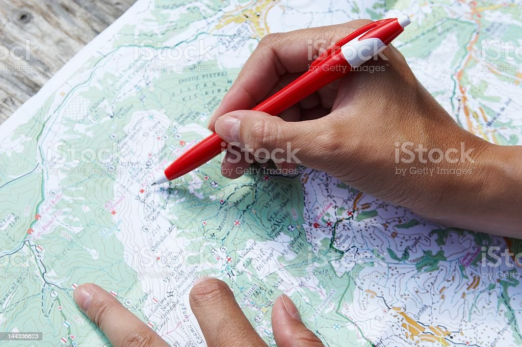 Hand on a map stock photo