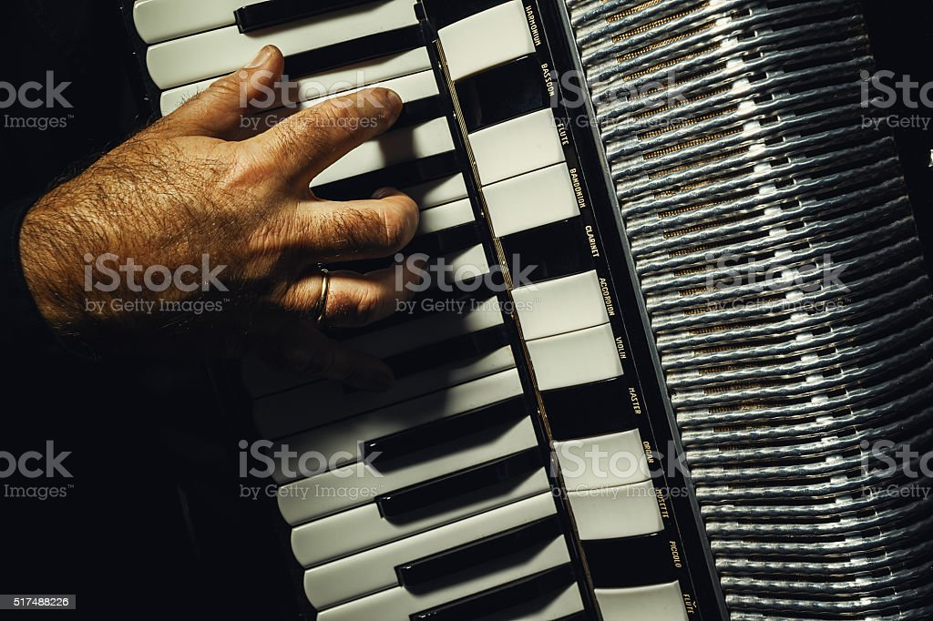 Hand on Accordion While Playing stock photo